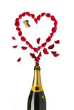 Heart shaped red rose petals champagne bottle. Heart shaped red rose petals popping out of champagne bottle on white background stock photo