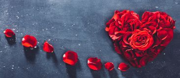 Heart-shaped red roses on stone background royalty free stock photo