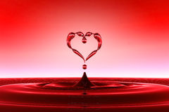 Heart shaped red water drops Stock Image