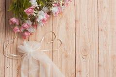 Heart shaped  ribbon and romantic flower Royalty Free Stock Photo