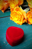 Heart shaped ring box and bouquet of roses Royalty Free Stock Photos