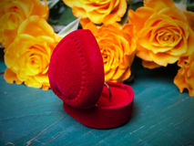 Heart shaped ring box and bouquet of roses Stock Photos
