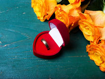 Heart shaped ring box and bouquet of roses Royalty Free Stock Photography