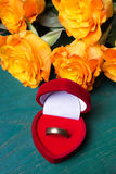 Heart shaped ring box and bouquet of roses Stock Photography