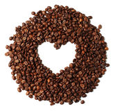 Heart shaped roasted coffee beans isolated on white bac Stock Images