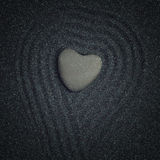 Heart shaped rock in a zen garden Stock Photos