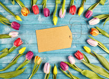 Heart shaped romantic frame of fresh spring tulips Royalty Free Stock Images