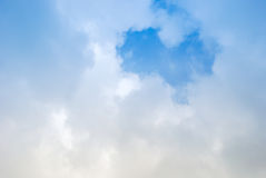 Heart Shaped Romantic Love Cloud in Blue Sky. Love! Romance! A heart shaped cotton ball cloud floats across a blue sky providing an abstract concept for affairs stock photo