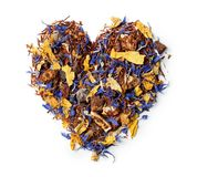 Heart shaped from rooibos tea with cornflower and orange slices isolated on white background. Stock Photo