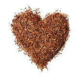 Heart shaped from rooibos tea isolated on white background royalty free stock photography