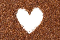 Heart shaped from rooibos tea on white background. Stock Image