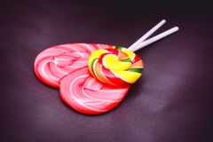Heart shaped and round spiral lollipops Royalty Free Stock Image