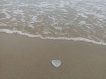 Heart-shaped on the sand beach. royalty free stock images