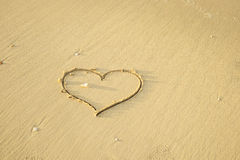 Heart shaped sand writing Royalty Free Stock Photography