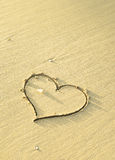 Heart shaped sand writing Stock Photo