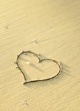 Heart shaped sand writing Stock Photo