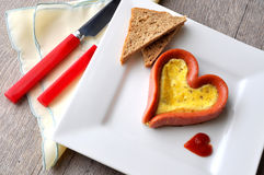 Heart-shaped sausage & egg Royalty Free Stock Images