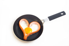 Heart shaped sausage with egg. Heart shaped sausage with fried eggs for Valentines day breakfast Stock Photography