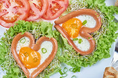 Heart shaped sausages with fried eggs Royalty Free Stock Image
