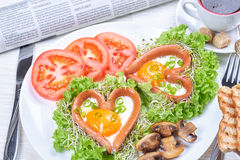 Heart shaped sausages with fried eggs Royalty Free Stock Photo