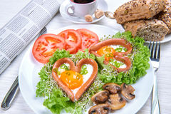 Heart shaped sausages with fried eggs Royalty Free Stock Images