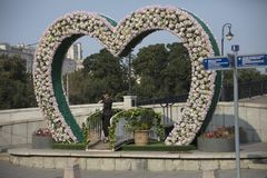 Heart Shaped Sculpture in Moscow. Heart shaped sculpture or edifice in Moscow Russia, adorned with flowers Royalty Free Stock Photo