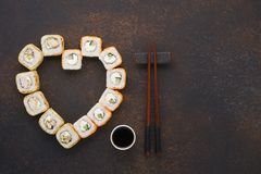 Heart shaped set of sushi rolls for Valentine`s Day. stock image