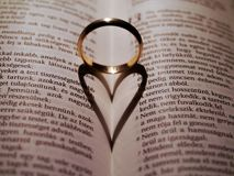 A heart shaped shadow on the Bible stock images