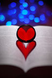 Heart shaped shadow on a book Royalty Free Stock Photo