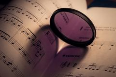 heart shaped shadow on music sheet royalty free stock photo