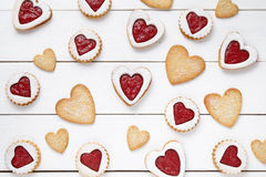 Heart shaped and shortbread cookies with jam gift composition for Valentines Day on vintage wooden background. Food concept of romantic love. Top view, flat Stock Photos