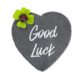 Heart-shaped sign with a four-leafed clover. A heart-shaped sign with a four-leafed clover stock photography