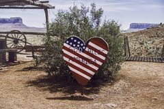 Heart-shaped wooden sign. A heart-shaped sign which represents the american flag with the inscription `God bless America Royalty Free Stock Photos