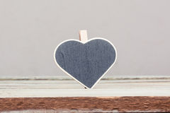 Heart shaped sign on wood table Royalty Free Stock Image