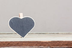 Heart shaped sign on wood table Stock Image