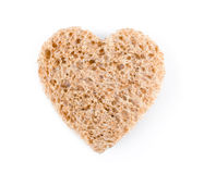Heart shaped in a slice of bread Royalty Free Stock Photo