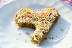 Bread with sprinkles. A heart-shaped slice of bread with sprinkles on it Royalty Free Stock Photo