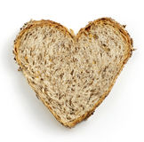 Heart shaped slice of brown bread Stock Photo
