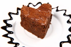 Heart shaped slice of a brownie Stock Images