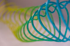 Heart shaped slinky. Detail of a colorful heart shaped slinky Royalty Free Stock Photos