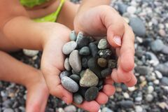 Free Heart Shaped Small Pebbles In Children`s Hands Stock Image - 185713031