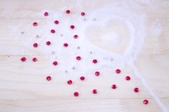 Heart shaped snow pattern and red stars Stock Photos