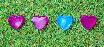Heart-shaped soap on green grass Stock Photo