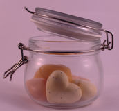Heart shaped soap in a transparent glass jar royalty free stock photos
