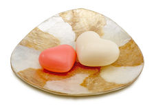 Heart shaped soaps on a dsish Royalty Free Stock Photos