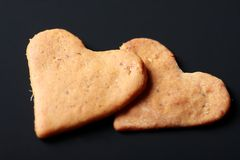 Heart shaped St. Valentine biscuits. Delcious heart shaped St. Valentine biscuits backed with love at home. On the black background Stock Photos