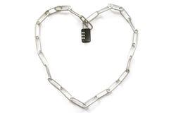 Heart-shaped steel strap with black keys. Stock Image