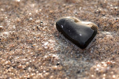 Heart shaped stone. Bathed by the sea's water Royalty Free Stock Images