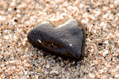 Heart Shaped Stone. Over sandy beach Royalty Free Stock Photography