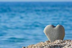 Heart shaped stone on a beach royalty free stock photo